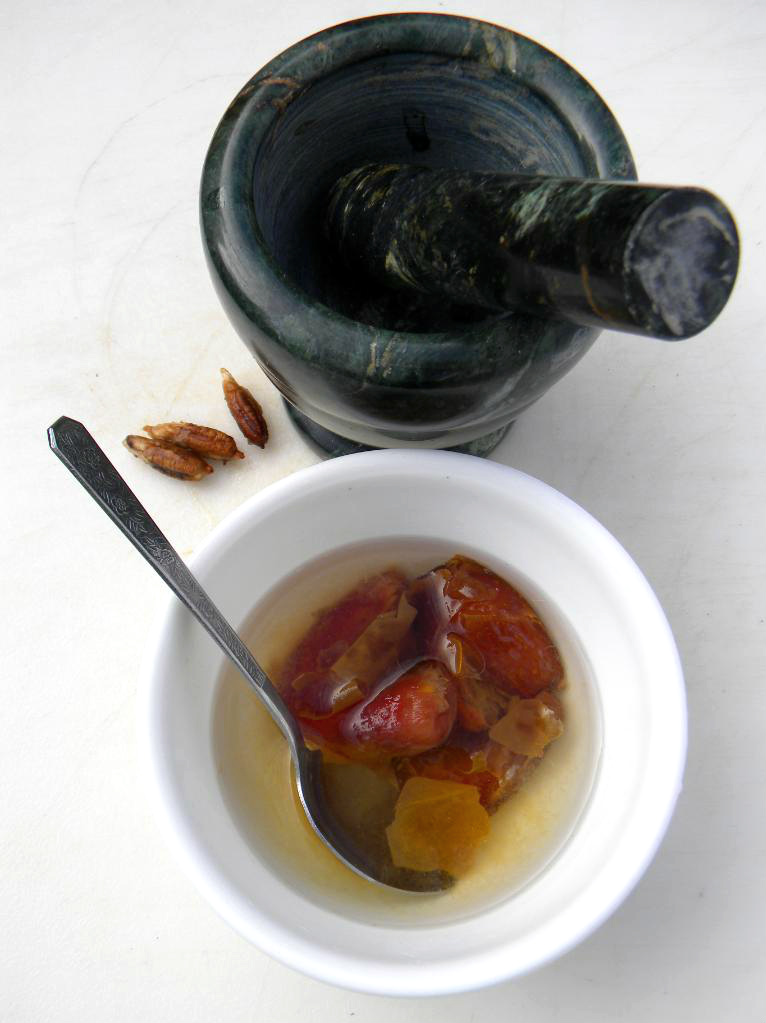 Mortar and pestle and a cup with soaked dates