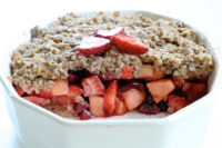 White porcelain bowl with strawberry and granola