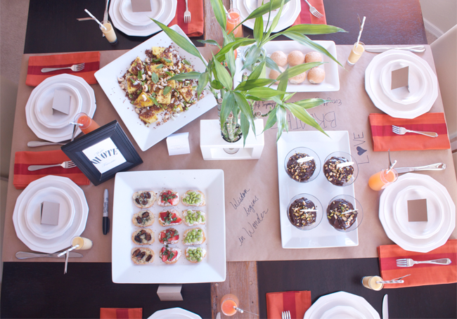 Aerial view of a table set for 8 with healthy food and a plant for centerpiece