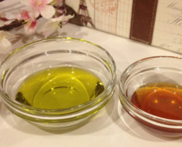 Two clear bowls with honey and olive oil