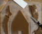Gingerbread house cut-out placed on baking paper