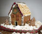 Close-up of a gingerbread house on a blanket of popcorn