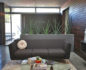 Stylish Mid-Century elements make for comfortable lounging in the open floor plan filled with plenty of natural light.