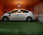 Lisa's battery-powered car charges in her post-consumer turf-lined garage!