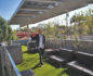 Marco shows off the brilliantly laid out solar panels over Lisa's sundeck. The panels feed the battery-powered cars in the home's garage.