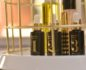 Close-up of a cosmetics display with 3 small bottles of Lustro face oil