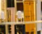 Close-up of a cosmetics display with a tall bottle of Lustro body oil