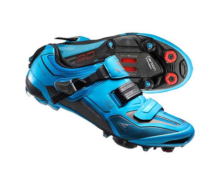 Pair of blue and black cycling shoes for spin bikes