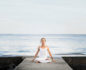 Woman in crown chakra yoga pose