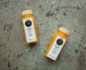 Two bottles of Pressed Juicery vitality shot on a stone background