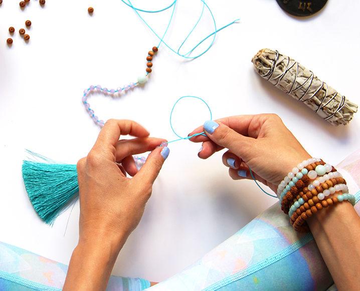 knotting a mala bead