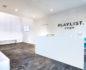 Medium shot of Playlist Yoga lounge and reception area
