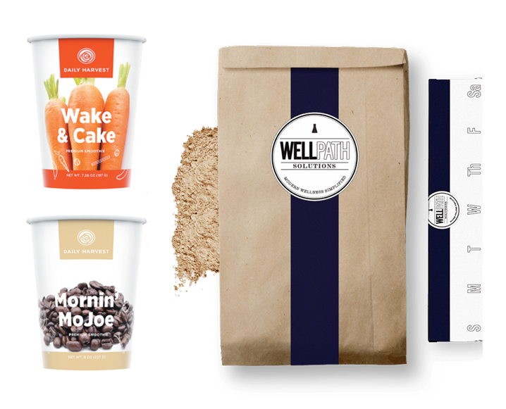 Two smoothie to-go cups from Daily Harvest next to a bag of Wellpath Solutions supplements