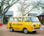Photo of a yellow, retro van parked in front of the Camp Comfort B&B