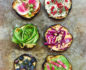 Aerial medium shot of 6 varying styles of eggplant toast placed in 2 vertical columns