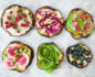 Aerial view of 6 varying styles of eggplant toast placed in 2 horizontal rows