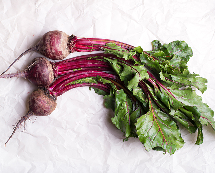 Bunch of 3 radishes on a white background