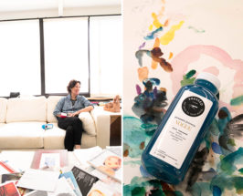 Kim McCarthy Artist sitting on white couch with pressed juicery bottle