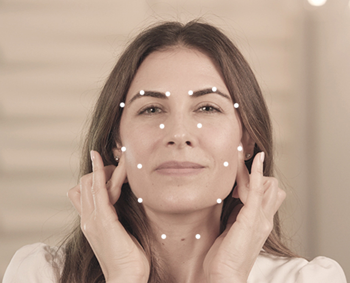 acupressure facial dots on womans face