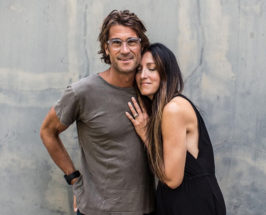 Athlete Rich Roll with his wife leaning on his shoulder