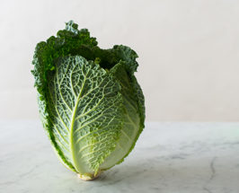 Medium shot of a head of cabbage on a marble surface