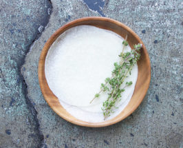 Aerial view of a wooden bowl with jicama tortillas and thyme