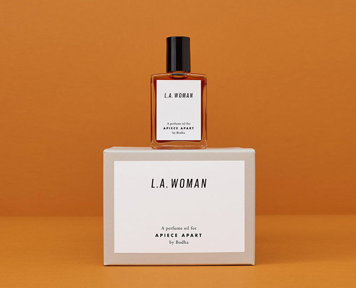 A box for L.A. Woman natural perfume with the bottle sitting on top of the box