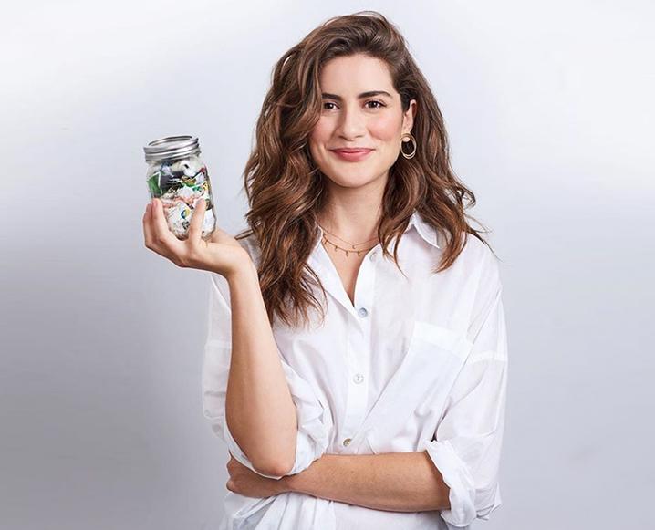 Lauren Singer of Low Waste Living holding a mason jar of trash