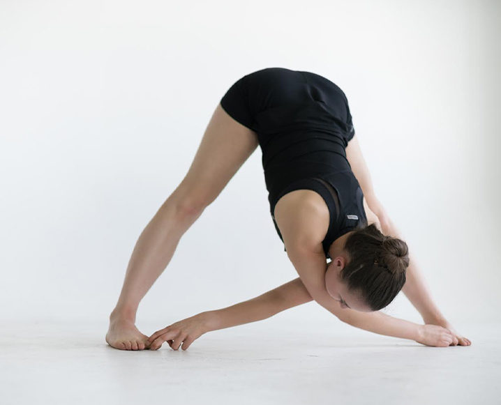 Woman performing the hamstring stretch routine
