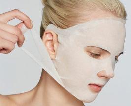 halloween beauty woman wearing white sheet mask