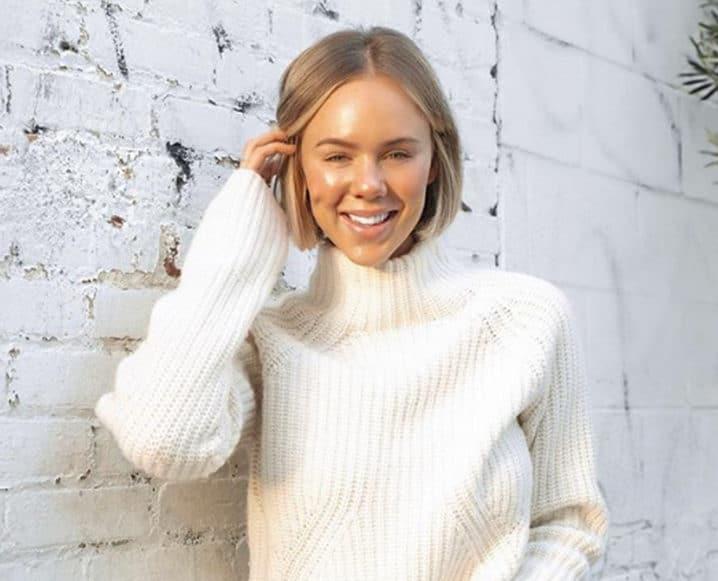 Celeste Thomas wearing white sweater