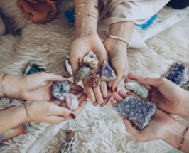 manifestion crystals held by friends