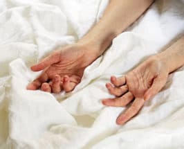Reiki healing hands on sheets