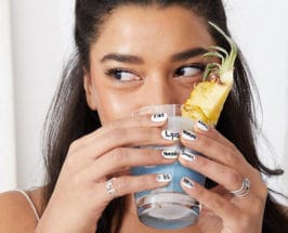 Hannah Bronfmans diet close up of face holding blue smoothie in glass cup