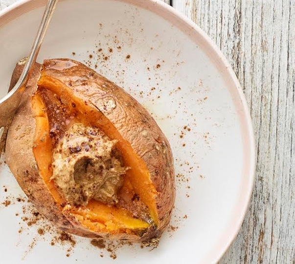 breakfast sweet potatoes topped with almond butter