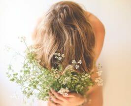 girl with flowers turmeric benefits