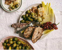 marinated olives with bread on plate