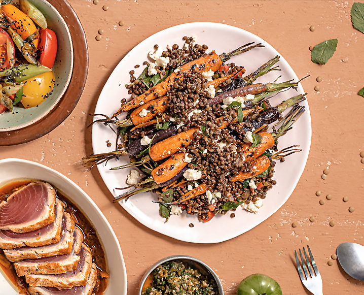 warm lentils salad on plate with carrots