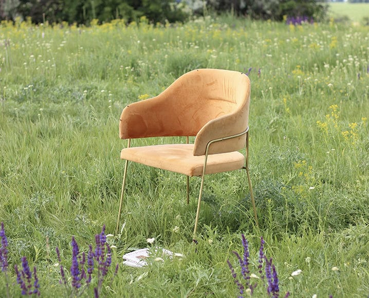 9 to 5 chair in a field