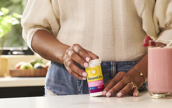 women's probiotic in hand